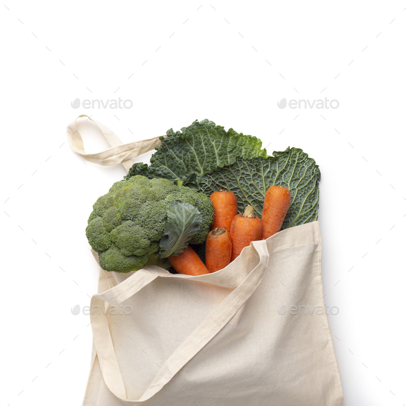 Reusable cotton bag with fresh bio vegetables isolated on white - Stock Photo - Images
