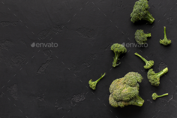 Heads of broccoli isolated on black background - Stock Photo - Images