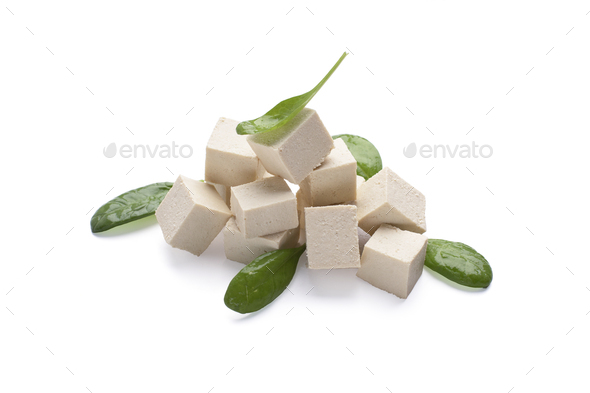 Uncooked tofu and green leaves of fresh spinach - Stock Photo - Images