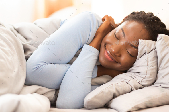 Asleep African American Lady Lying In Bed At Home - Stock Photo - Images