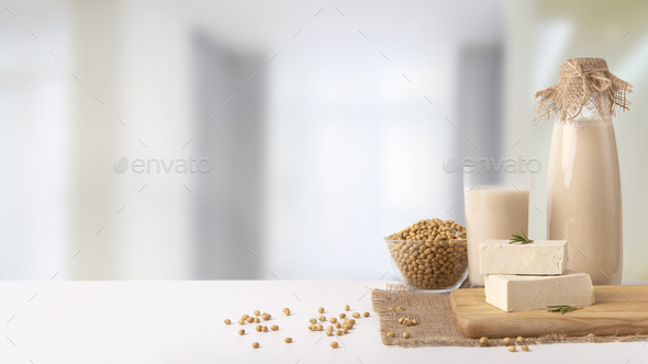 Set of soy milk, tofu cheese and beans on kitchen table - Stock Photo - Images