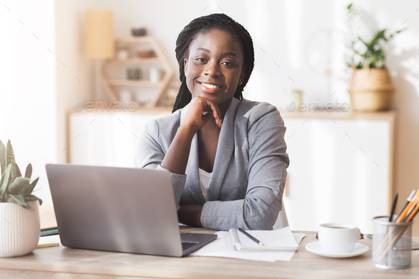 Smiling Afro Businesswoman Sitting At The Laptop In Modern Office - Stock Photo - Images