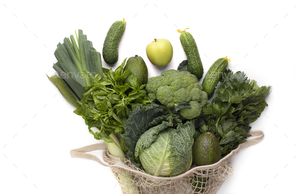 Green bunch of fruits and vegetables inside vintage mesh bag - Stock Photo - Images