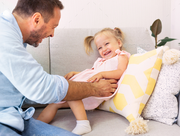 Father playing and tickling cute little daughter - Stock Photo - Images