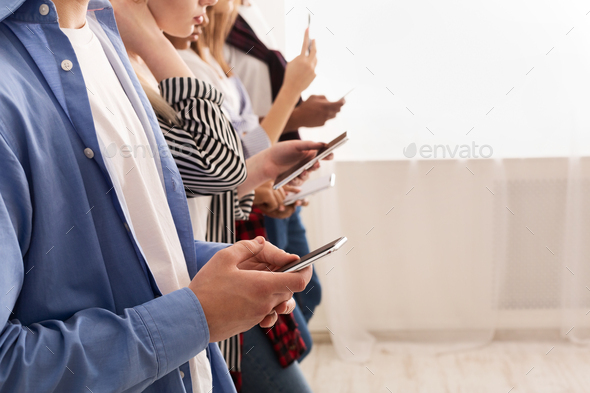 Teenagers addicted to new technology trends, using smartphones - Stock Photo - Images