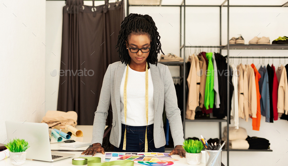 African American Woman Designing Clothes Working In Designer's Workshop - Stock Photo - Images