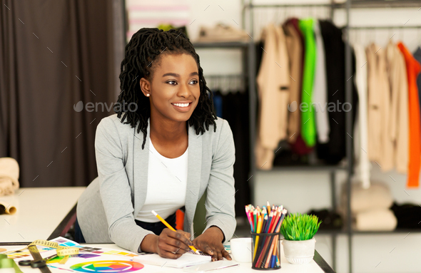 African American Tailor Lady Drawing Sketches Working In Atelier - Stock Photo - Images