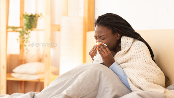 Sick Black Girl Blowing Nose Sitting In Bed, Panorama - Stock Photo - Images