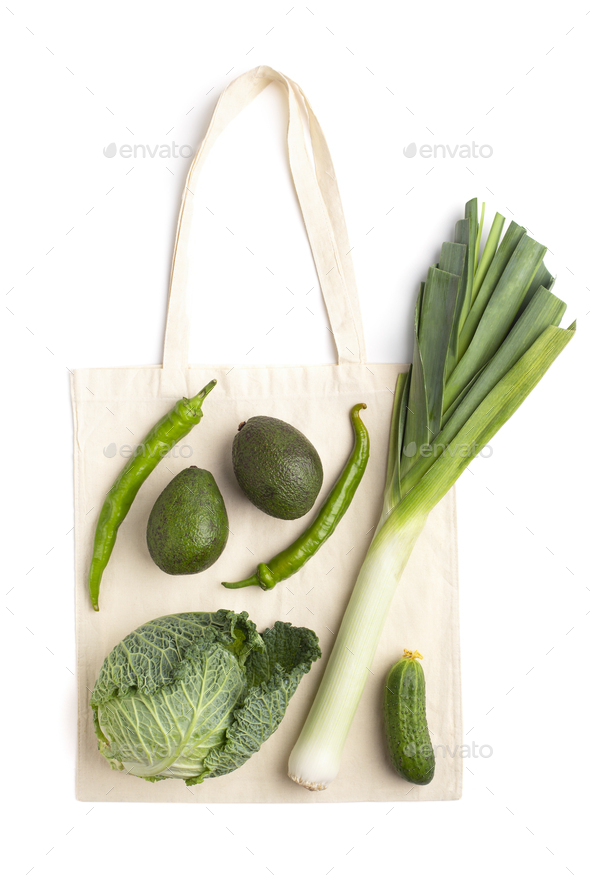 Creative composition of organic green vegetables and zero waste shopping bag - Stock Photo - Images