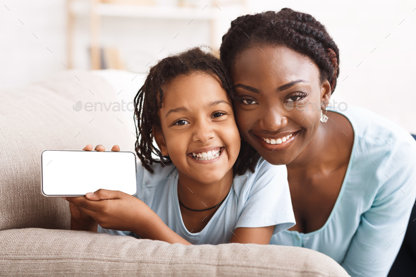 Mockup image of afro family showing mobile phone - Stock Photo - Images