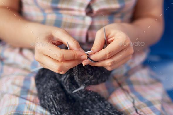 Woman knitting wool socks - Stock Photo - Images