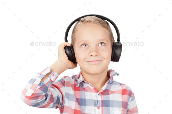 Young boy listening to music - Stock Photo - Images