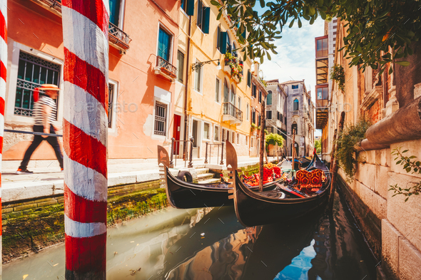 Gondolas boat floating in narrow canal of Venice city on beautiful sunny day. Italy. Europe - Stock Photo - Images