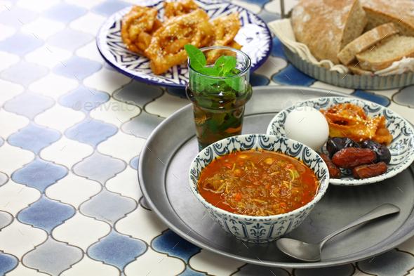 moroccan ramadan iftar meal, harira soup, chebakia, dates, mint tea and khubz - Stock Photo - Images