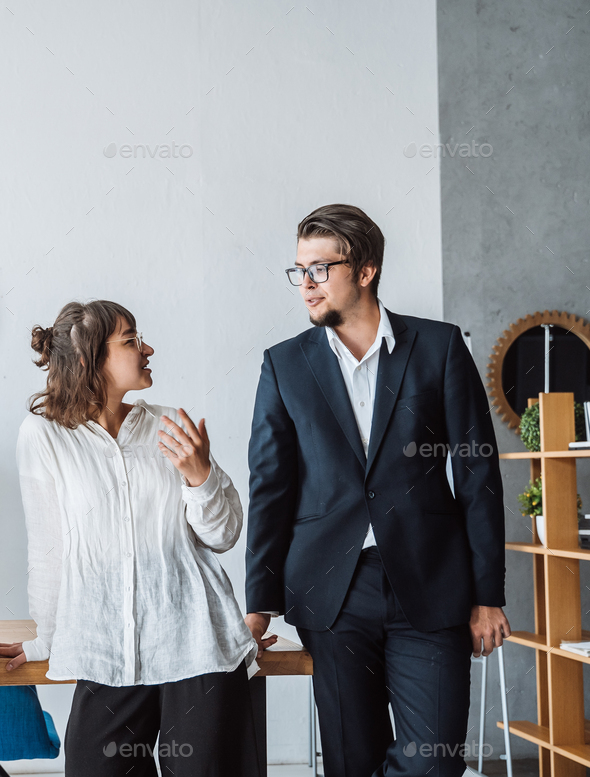 Business People standing in the office discuss - Stock Photo - Images