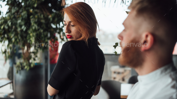 Beautiful woman in a black dress and a man in a white shirt - Stock Photo - Images