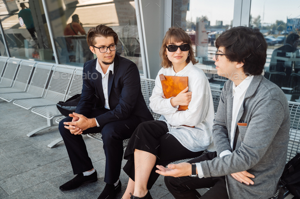 Two businessmen and a secretary discuss an important issue outside - Stock Photo - Images