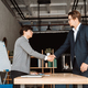 Two happy satisfied businessmen shaking hands over - PhotoDune Item for Sale