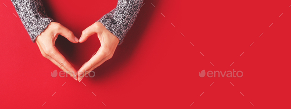 Red Banner with Female's Hands in Shape of Heart. - Stock Photo - Images
