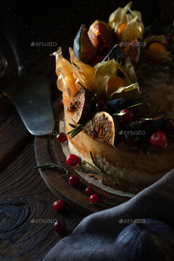 Cheesecake with physalis and dates and wild berries - Stock Photo - Images