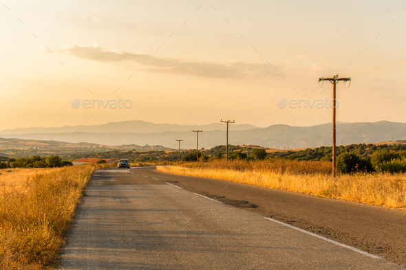 Car on the road and fields in Greece - Stock Photo - Images