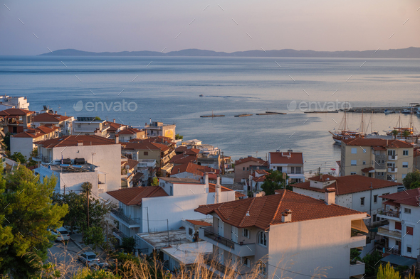 Sea and houses with red roofs in Greece aerial view - Stock Photo - Images