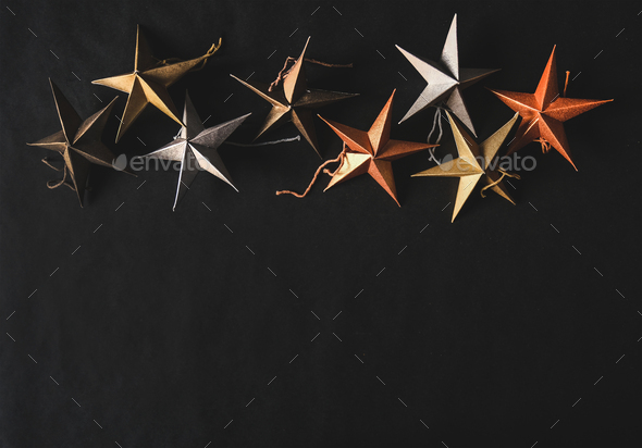 Christmas and New Year decorative toy stars over black background - Stock Photo - Images