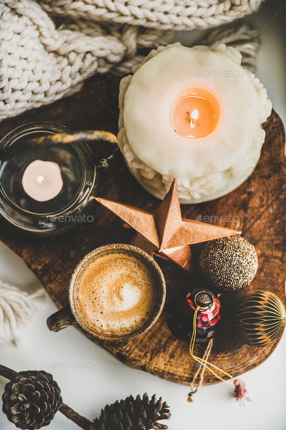 Flat-lay of Christmas composition with coffee, candles and decorative toys - Stock Photo - Images
