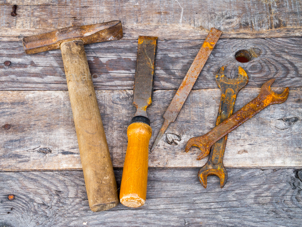 Old rusty vintage tools on weathered background - Stock Photo - Images