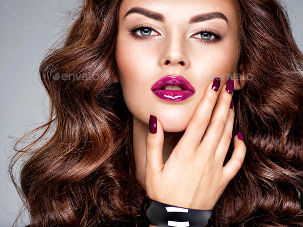Beautiful and stunning woman with  purple lipstick on lips and fingernails. - Stock Photo - Images