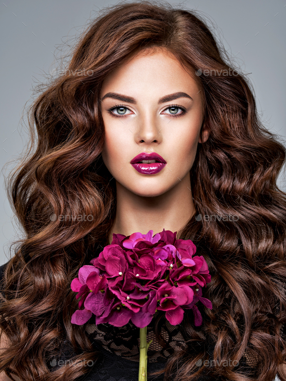 Stunning woman with long  hair and bright violet make-up. - Stock Photo - Images
