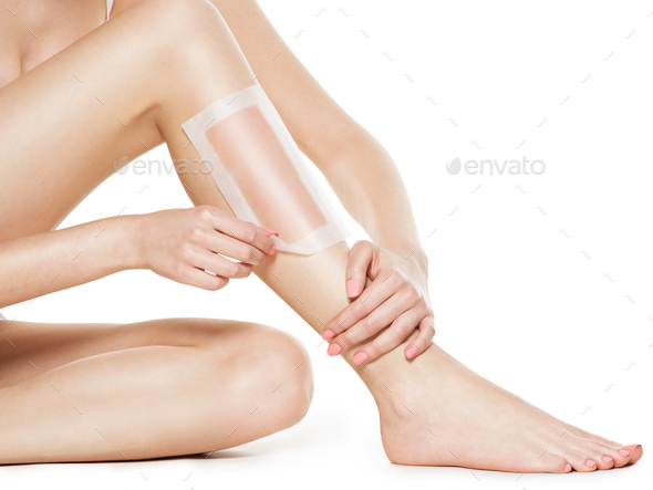 woman depilating legs by waxing - Stock Photo - Images