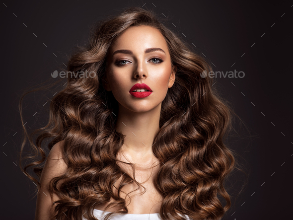 Beautiful woman with long brown hair and red lipstick. - Stock Photo - Images