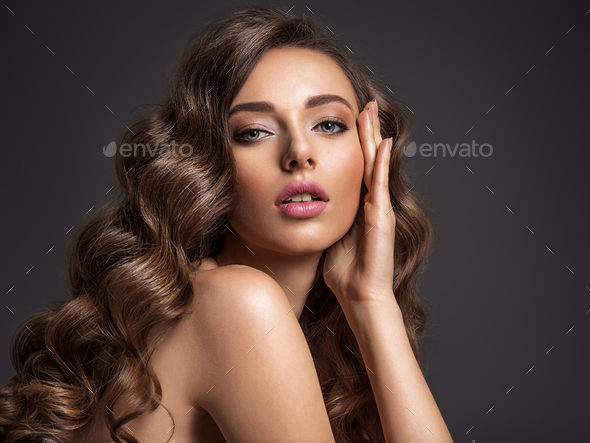 Beautiful woman with long brown hair. - Stock Photo - Images