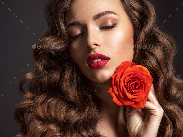 Beautiful woman with brown hair. - Stock Photo - Images