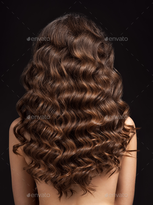 Girl with long, curly hair, rear view. Hair texture, close-up. - Stock Photo - Images