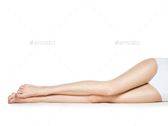 Woman legs isolated on white background - Stock Photo - Images