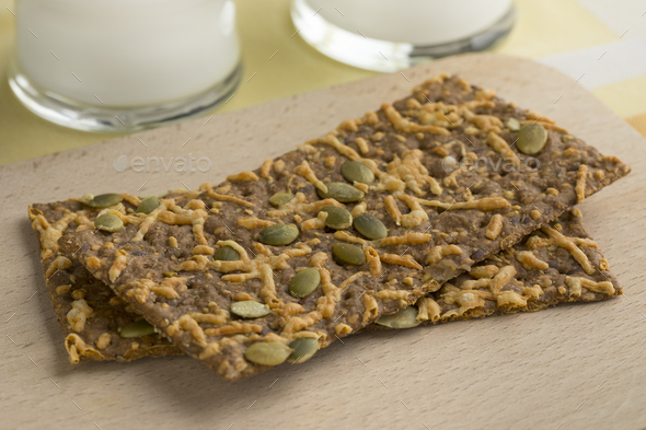 Close up of cheese cracker with pumpkin seed - Stock Photo - Images
