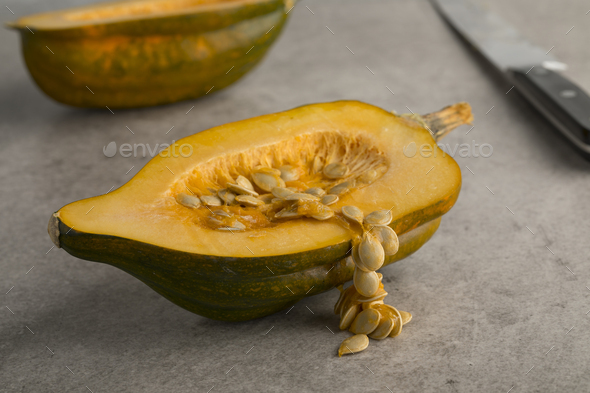 Seeds of a halved fresh acorn squash close up - Stock Photo - Images