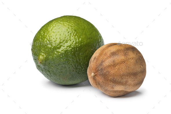 Fresh green and dried whole white limes - Stock Photo - Images
