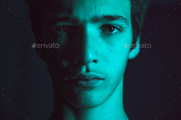 Portrait of a young man. Portrait of a handsome man, looking in the camera. - Stock Photo - Images