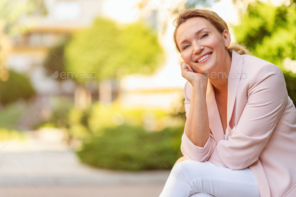 Close-up portrait of a smiling woman on the street. - Stock Photo - Images