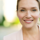 Close-up portrait of a smiling woman on the street. - PhotoDune Item for Sale