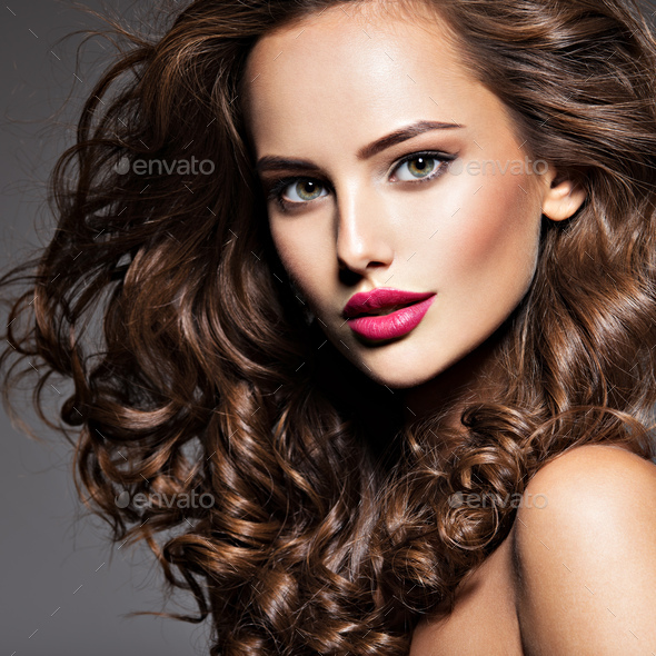 beautiful face of young  woman with long brown hair - Stock Photo - Images
