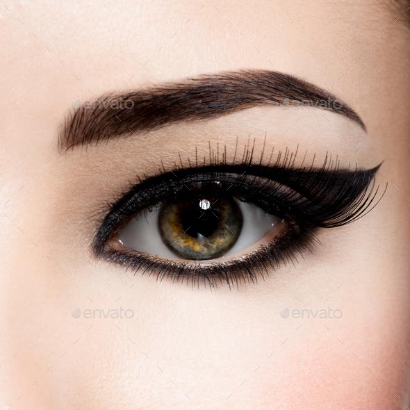 Closeup female eye with creative fashion make-up. brown eyeshadow - Stock Photo - Images