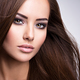 Portrait of Beautiful young woman with long straight brown hair. - PhotoDune Item for Sale