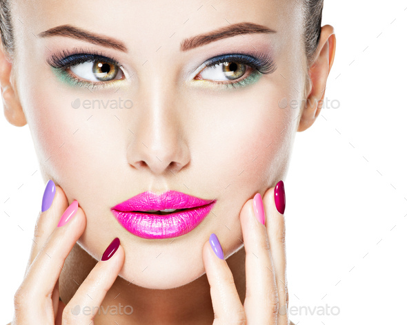 Attractive Face of a beautiful woman  with fashion makeup. - Stock Photo - Images