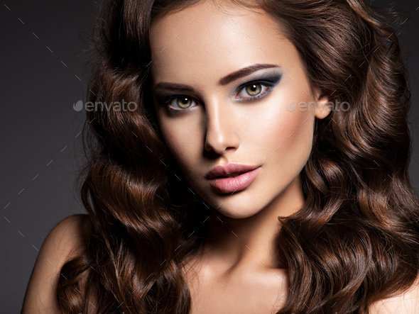 Beautiful woman with long curly hair - Stock Photo - Images