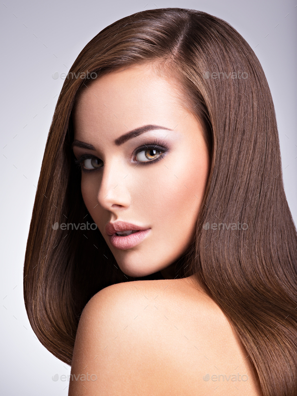 Portrait of Beautiful young woman with long straight brown hair. - Stock Photo - Images