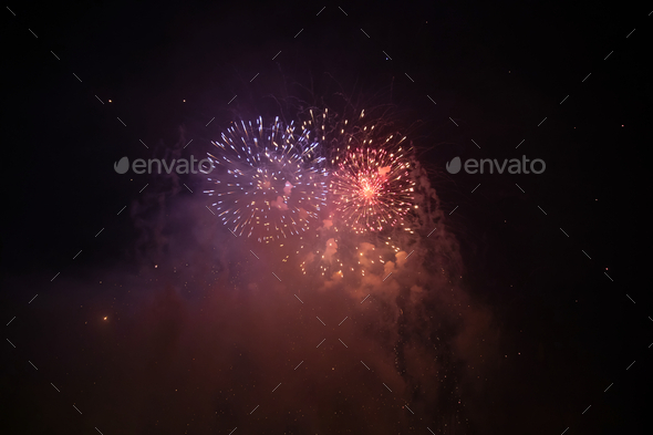 Fireworks at New Year. Abstract holiday background. - Stock Photo - Images